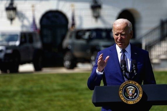 U.S. President Joe Biden speaks during an event on clean cars and trucks on the South Lawn of the White House in Washington, D.C., the United States, on Aug. 5, 2021. (Photo by Ting Shen/Xinhua/IANS)