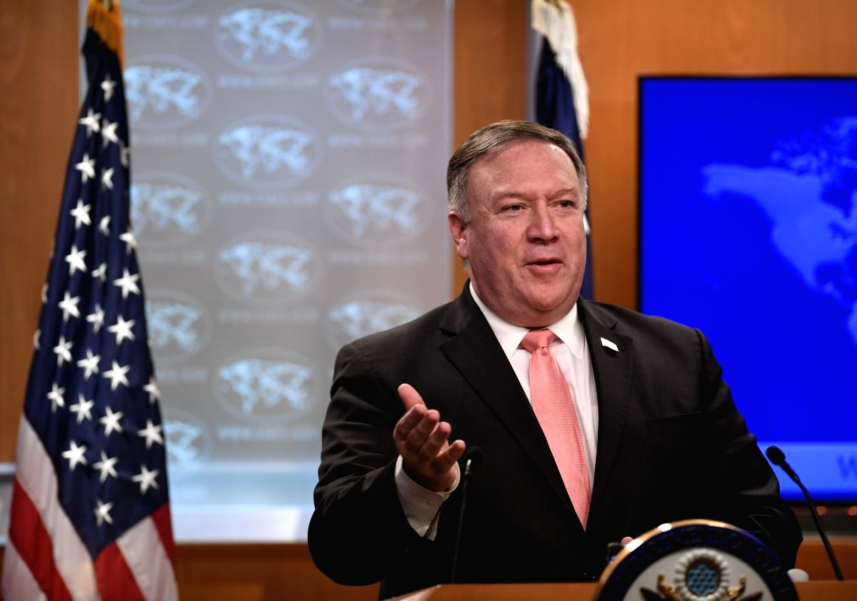 :U.S. Secretary of State Mike Pompeo speaks during a press briefing in Washington D.C., the United States, Oct. 23, 2018. The United States is revoking visas ...