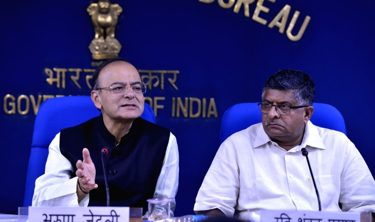 Union Ministers Arun Jaitley and Ravi Shankar Prasad at a press conference in New Delhi on Aug. 16, 2017.
