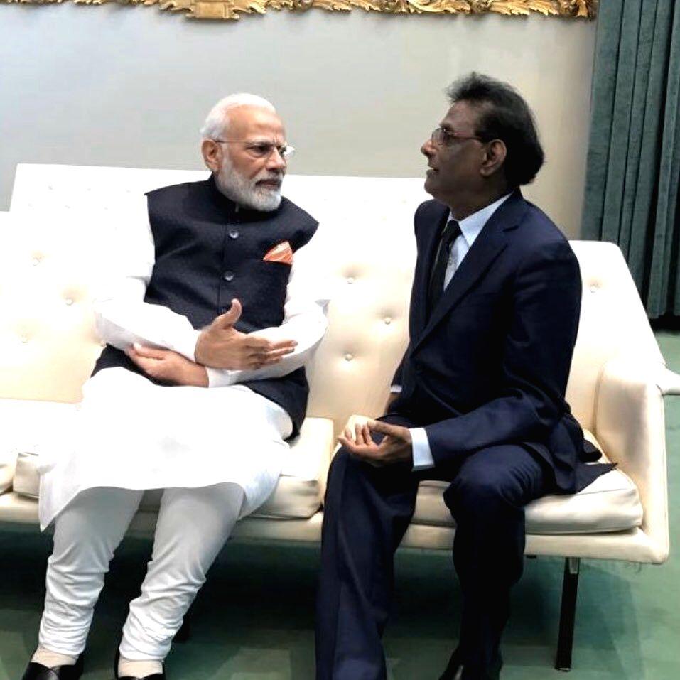 United Nations: Prime Minsiter Narendra Modi meets Mauritius President Mauritius President Paramasivum Pillay Vyapoory on the sidelines of UNGA 74 at United Nations on Sep 27, 2019. (Photo: Twitter/@MauritiusPM)