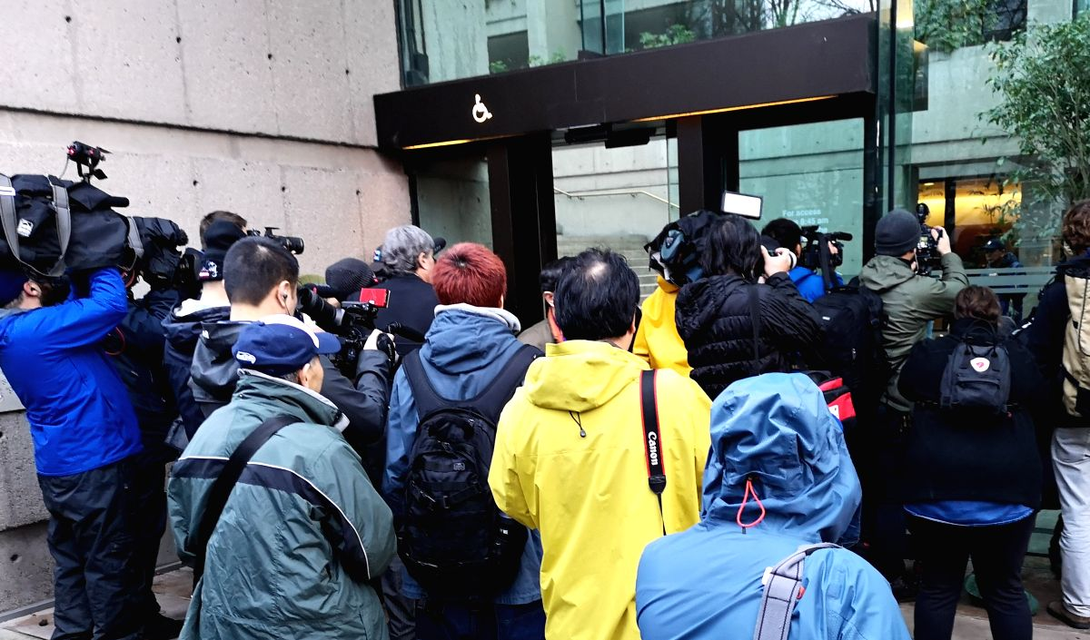 VANCOUVER, Dec. 12, 2018 (Xinhua) -- Journalists wait outside the Supreme Court of British Columbia in Vancouver, Canada, on Dec. 11, 2018. A Canadian judge ruled on Tuesday that Meng Wanzhou, chief financial officer of China's Huawei Technologies Co