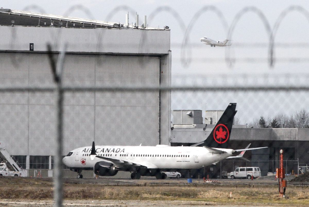 VANCOUVER, March 13, 2019 (Xinhua) -- An Air Canada Boeing 737 Max 8 aircraft is seen at a maintenance building at Vancouver International Airport in Richmond, Vancouver, Canada, March 13, 2019. Canada is grounding all its Boeing 737 Max 8 aircraft a