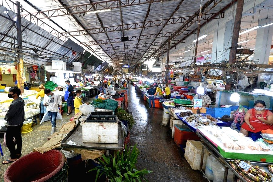 Vendors sell seafood and vegetables in a market in Samut Sakhon province, Thailand. (Xinhua/Rachen Sageamsak/IANS)