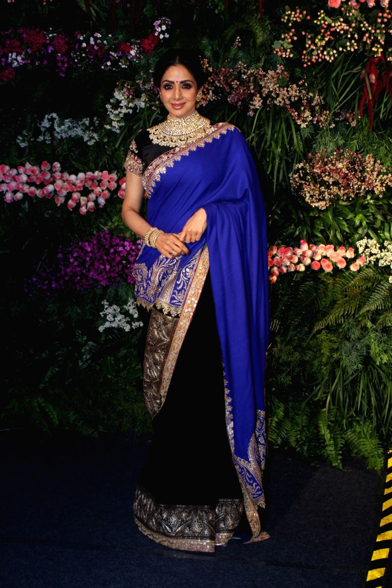 Sridevi looks regal in this midnight blue saree with intricate brocade work and elaborate embroidered neckline