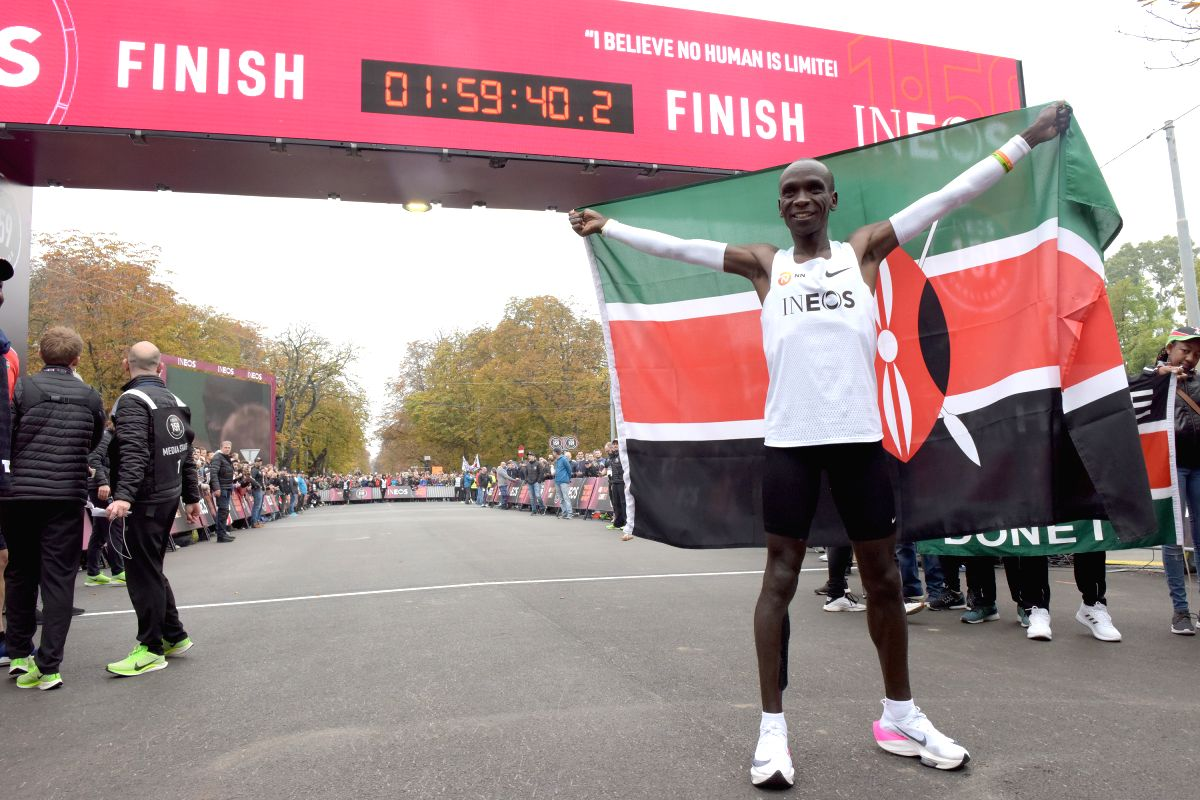 """VIENNA, Oct. 12, 2019 (Xinhua) -- Kenya's Eliud Kipchoge celebrates at the finish line after the match of """"1:59 challenge"""" in Vienna, Austria, on Oct. 12, 2019. Eliud Kipchoge completed the """"1:59 challenge""""  successfully in 1h 59m 40.2s. (Xinhua/Guo"""