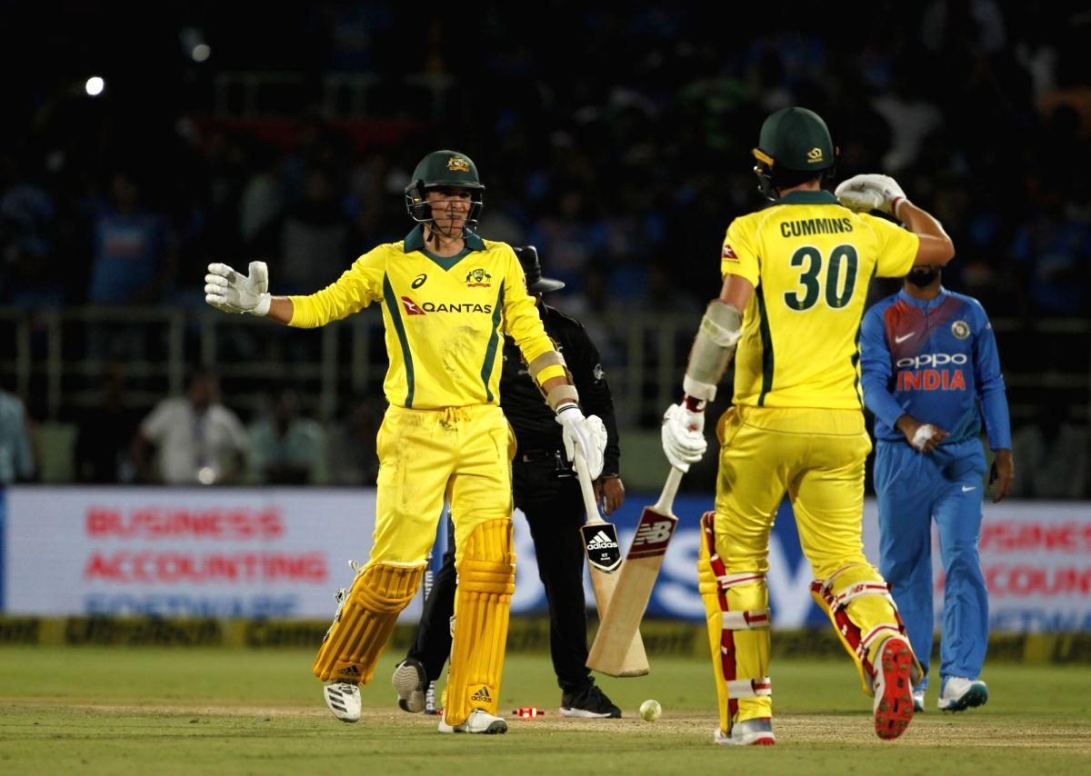 Visakhapatnam: Pat Cummins and Jhye Richardson of Australia celebrates after winning the 1st T20I match against India at Dr. Y.S. Rajasekhara Reddy ACA-VDCA Cricket Stadium in Visakhapatnam, Andhra Pradesh on Feb 24, 2019. (Photo: Surjeet Yadav/IANS)
