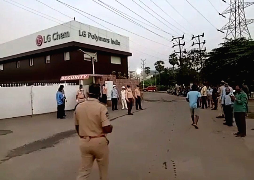 Visakhapatnam: Police personnel at the LG Polymers unit located at RR Venkatapuram near Gopalapatnam in Visakhapatnam, Andhra Pradesh where gas leakage left one minor among 7 people dead, more than 70 left unconscious, with at least five sleeping ham