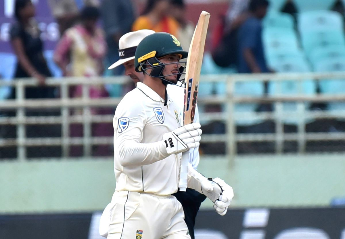 Visakhapatnam: South Africa's Quinton de Kock celebrates his half century on Day 3 of the 1st Test match between India and South Africa at Dr. Y.S. Rajasekhara Reddy ACA-VDCA Cricket Stadium in Visakhapatnam on Oct 4, 2019.