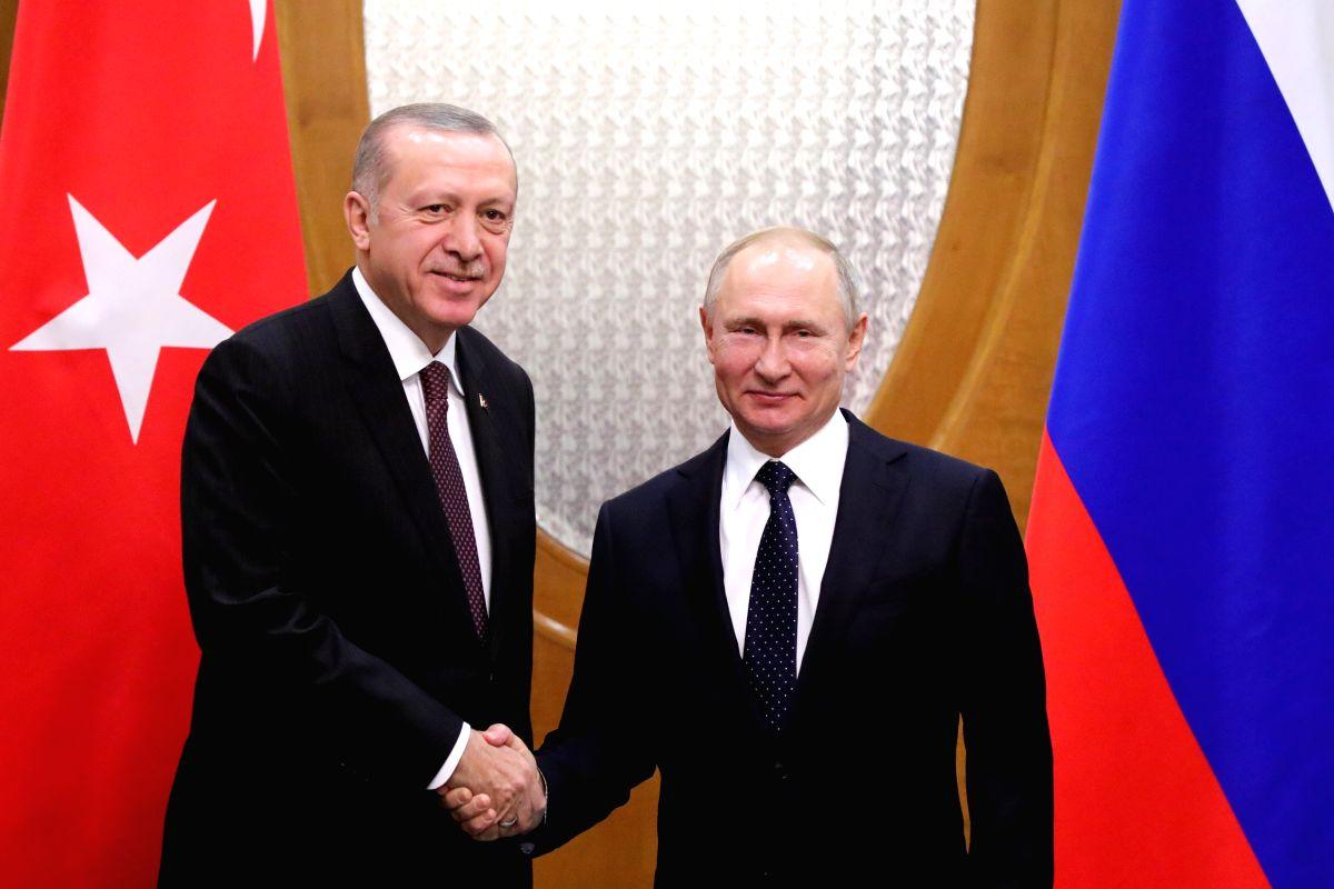 Vladimir Putin (R) shakes hands with Turkish President Recep Tayyip Erdogan. (Xinhua/Sputnik/IANS)