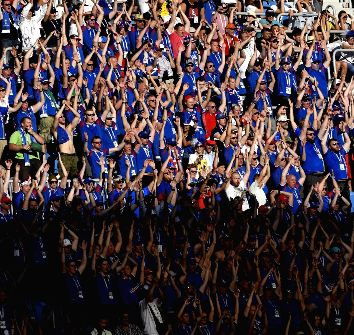 Iceland fans cheer their team in the match against Nigeria