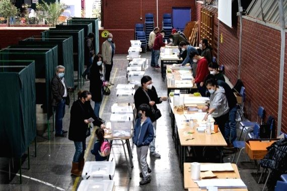 Voters register to cast their ballots at a voting center in Santiago, Chile, on May 15, 2021. (Photo by Jorge Villegas/Xinhua/IANS)