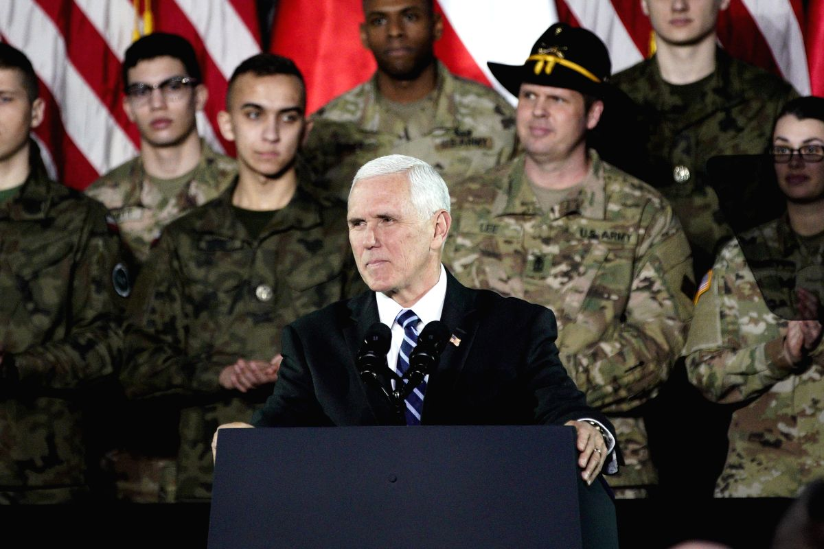 WARSAW, Feb. 13, 2019 (Xinhua) -- U.S. Vice President Mike Pence (C) speaks to the troops at a military base in Warsaw, Poland, on Feb. 13, 2019. Pence's visit to Warsaw includes the two-day conference on the Middle East co-organized by the United St