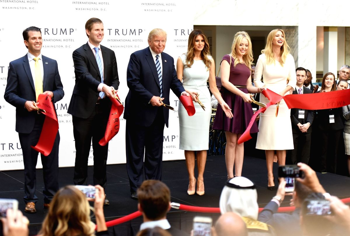 WASHINGTON D.C., Oct. 26, 2016 - U.S. Republican presidential nominee Donald Trump (3rd L) and his family members cut the ribbon during the opening and ribbon cutting ceremony of Trump International ...