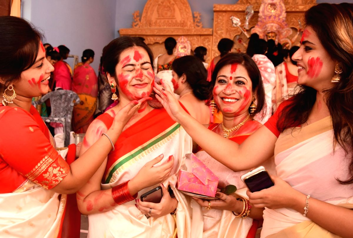 And after Devi Boron, women smear each other with sindoor