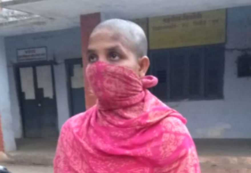 Woman tonsured by husband.