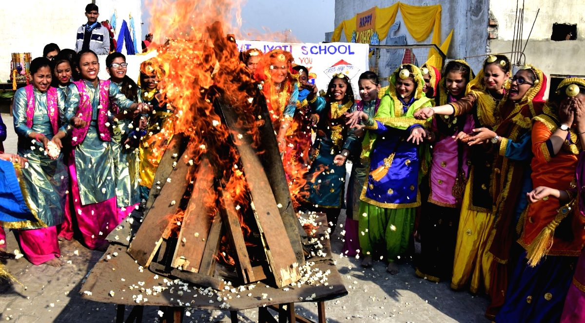 Amritsar: Women celebrate on the eve of Lohri in Amritsar on Jan 12, 2017.
