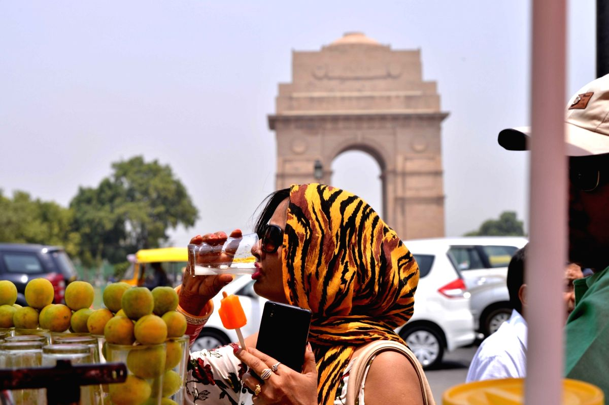 Women cover themselves to avoid scorching sun on a hot day in New Delhi on May 23, 2018.