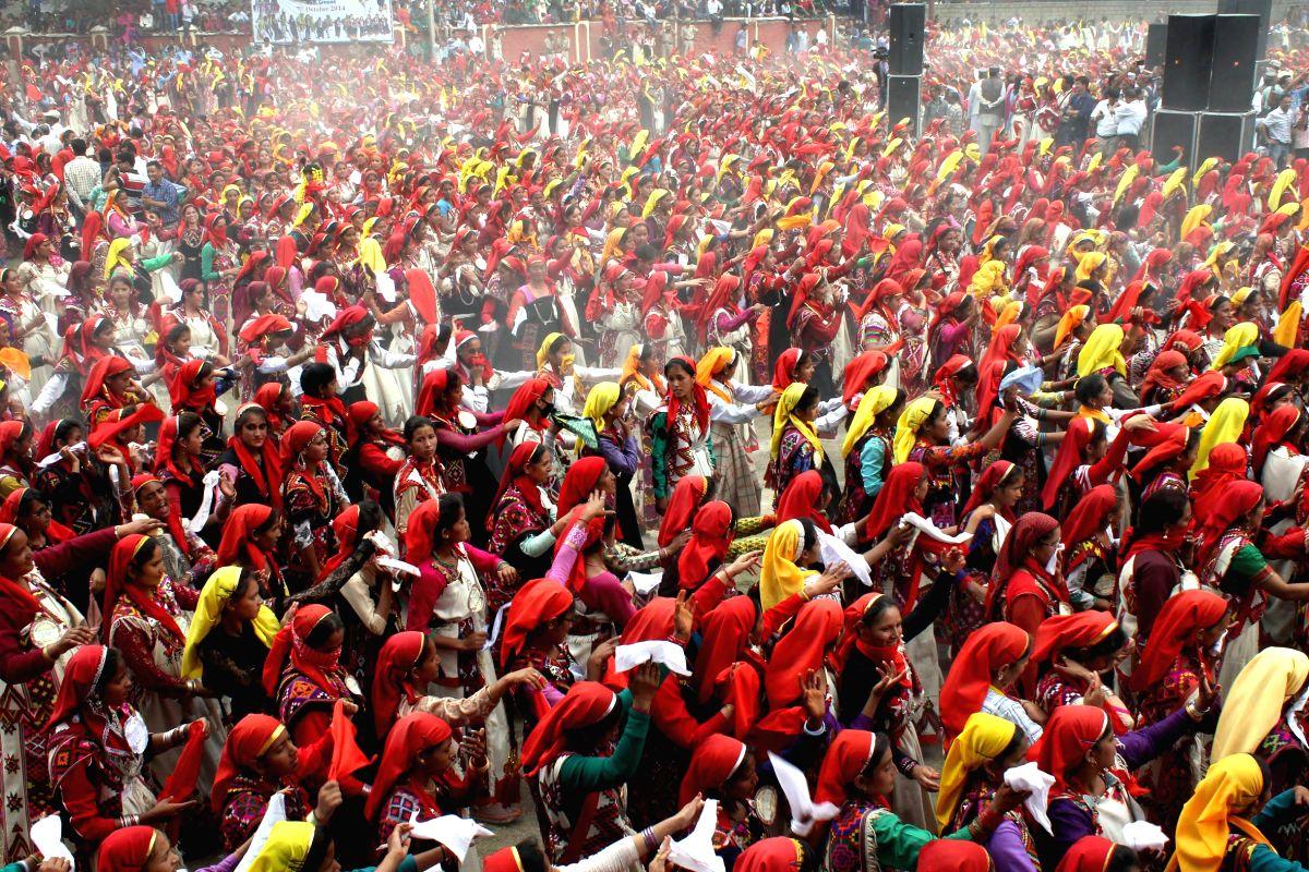 Women in large numbers participate in international Kullu Dussehra festival  in Kullu, Himachal Pradesh, on Oct.7, 2014.