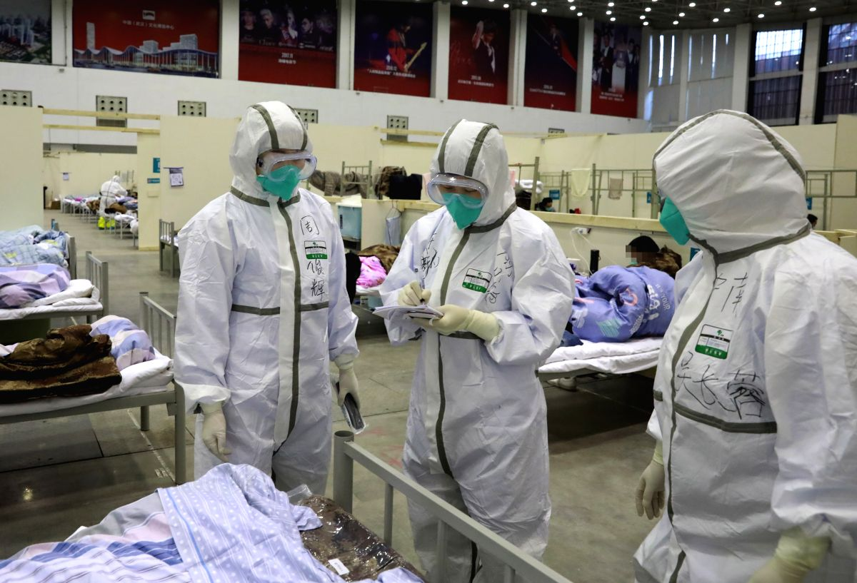 """WUHAN, Feb. 9, 2020 (Xinhua) -- Medical workers work at """"Wuhan Livingroom"""" in Wuhan, central China's Hubei Province, Feb. 8, 2020. The cultural building complex dubbed """"Wuhan Livingroom"""" is a converted hospital to receive patients infected with the n"""