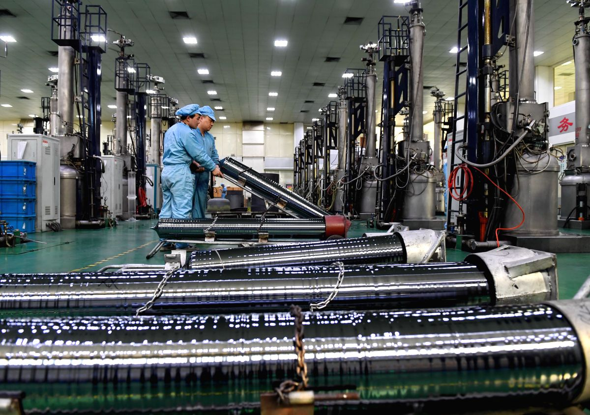XINGTAI, March 1, 2017 (Xinhua) -- Photo taken on Feb. 24, 2017 shows workers carrying a monocrystalline silicon stick at a factory in Ningjin County, north China's Hebei Province. China's manufacturing purchasing managers' index (PMI) came in at 51.