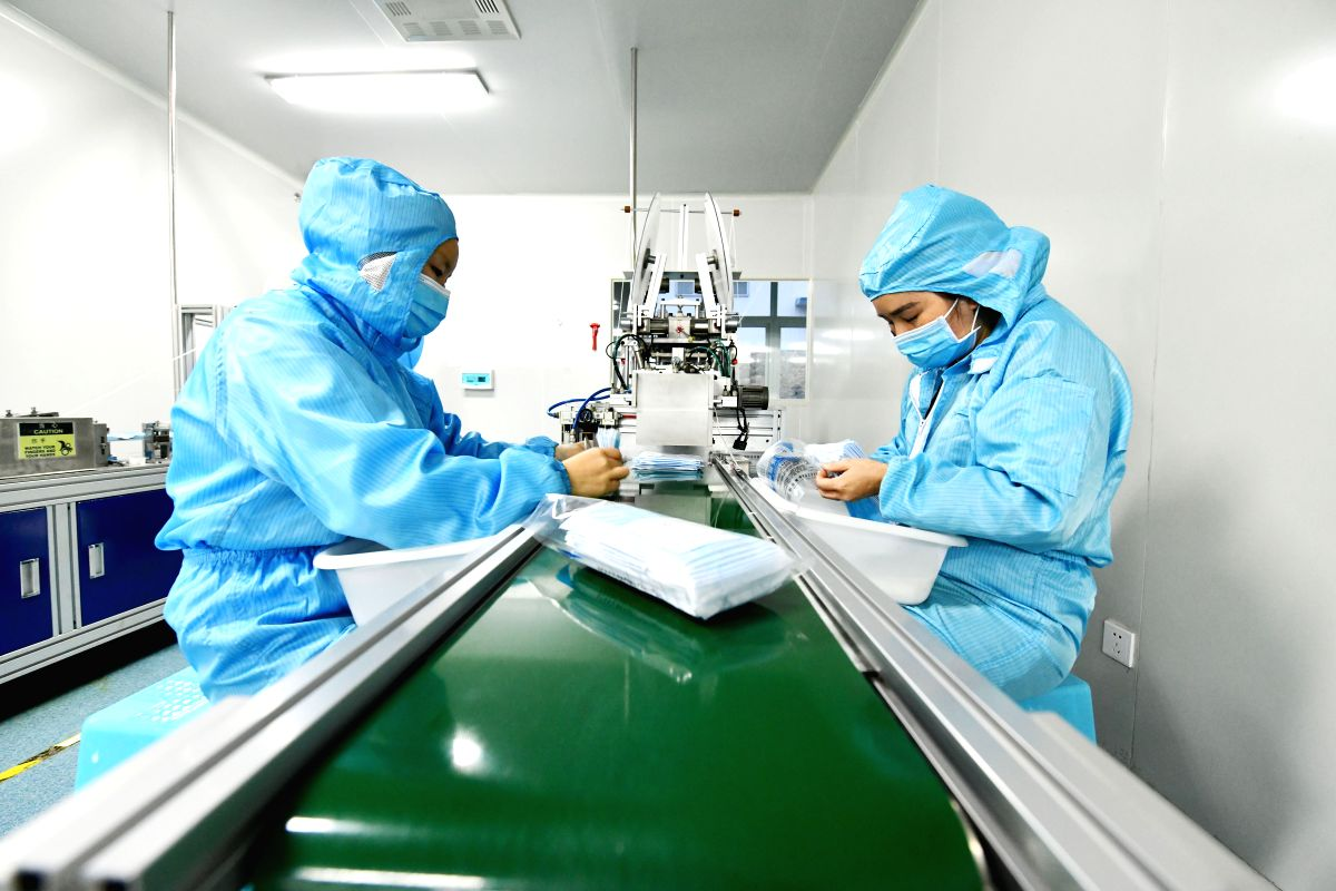 XINGYI, Feb. 22, 2020 (Xinhua) -- Workers of Junjiang Industrial Limited Company produce medical masks in Yilong New District at Bouyei-Miao Autonomous Prefecture of Qianxinan in southwest China's Guizhou Province, Feb. 21, 2020. Medical supply compa