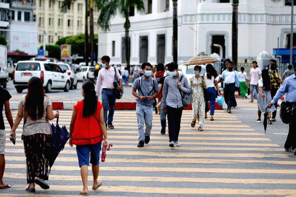 YANGON, July 10, 2020 (Xinhua) -- People walk across a road in Yangon, Myanmar, on July 10, 2020. The number of COVID-19 infection cases has risen to 326 as of Friday, according to latest figures by the Ministry of Health and Sports. (Xinhua/U Aung/I