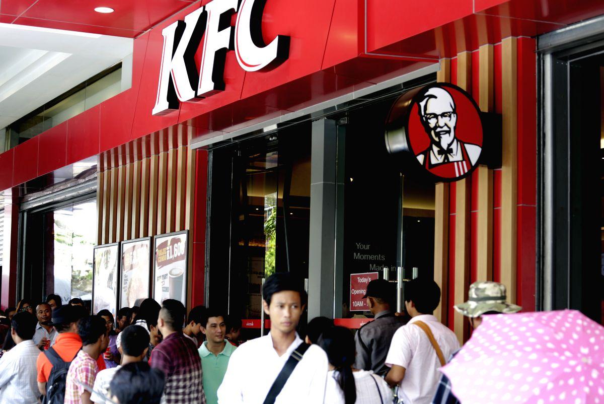 YANGON, July 2, 2015 (Xinhua) -- People wait to buy fried chicken outside a KFC branch in Yangon, Myanmar, July 2, 2015. Leading fast food brand KFC opened its first branch in Myanmar on June 30. (Xinhua/U Aung/IANS)