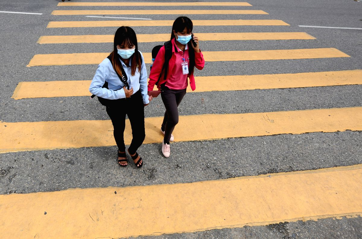 YANGON, June 19, 2020 (Xinhua) -- People wearing masks walk in downtown Yangon, Myanmar, June 19, 2020. A total of 23 new imported COVID-19 cases were reported in Myanmar on Friday morning, bringing the total number of infections to 286 in the countr