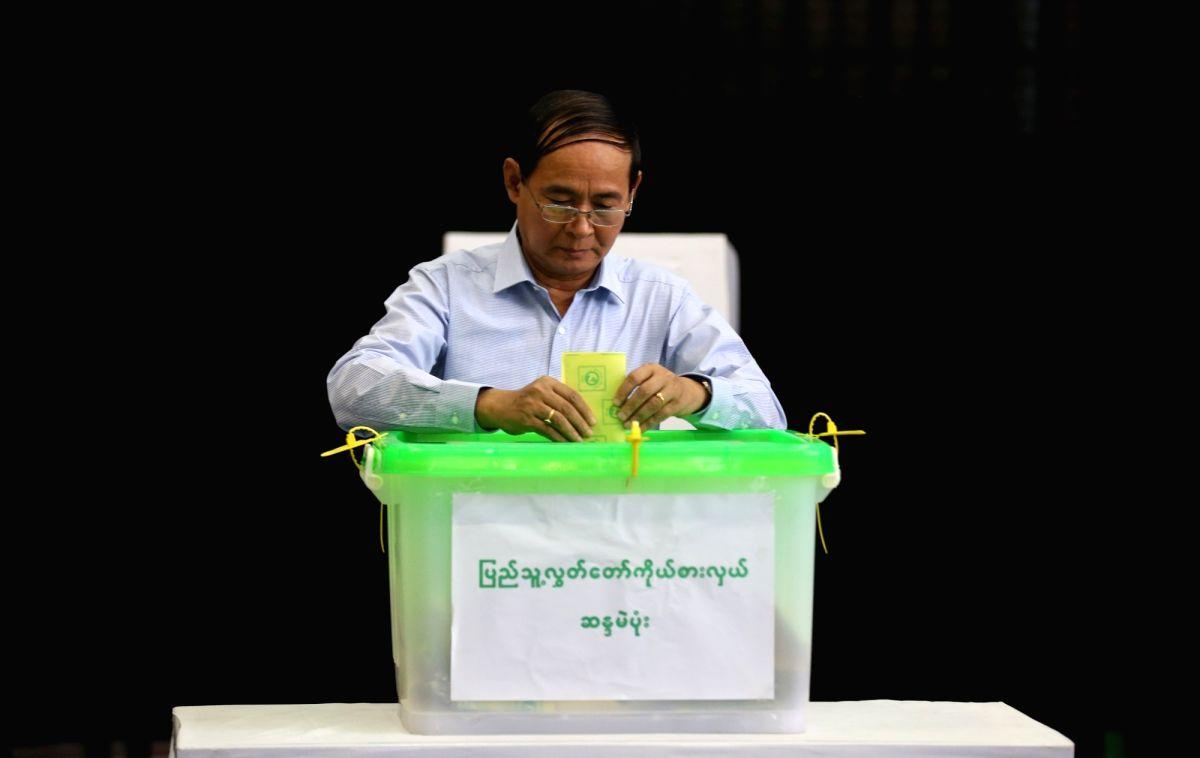 YANGON, Nov. 3, 2018 - Myanmar President U Win Myint casts ballot at a polling station in Yangon, Myanmar, Nov. 3, 2018. Myanmar President U Win Myint cast his votes in Yangon's Tarmwe township ...