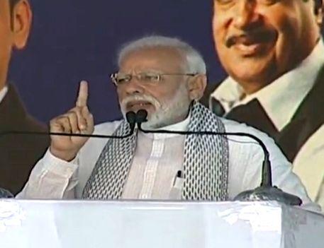 Yavatmal: Prime Minister Narendra Modi addresses during a programme organised to inaugurate development projects in Yavatmal, Maharashtra on Feb 16, 2019. (Photo: IANS/BJP)