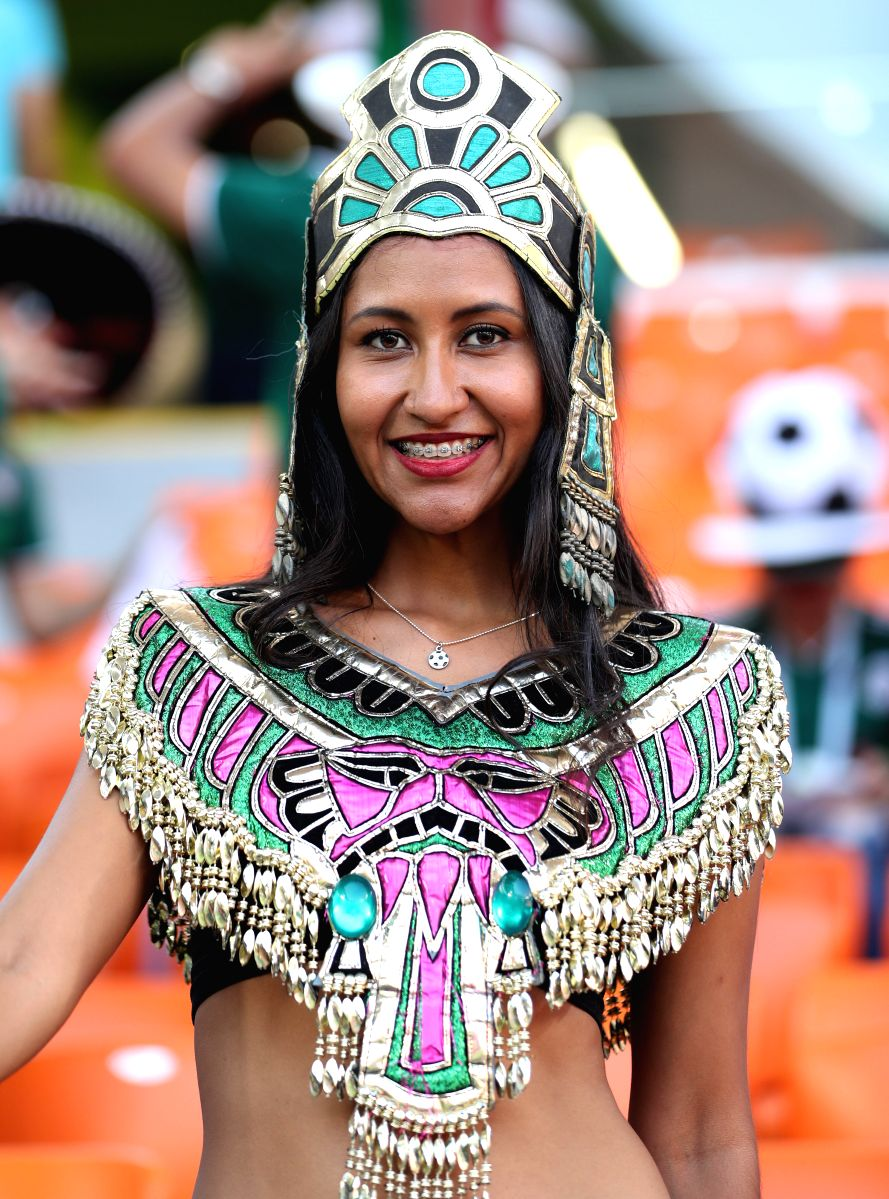 A fan sports a vibrant attire in the match between Mexico and Sweden