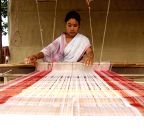 Assam: A woman weaves Assamese gamacha ahead of Rongali Bihu