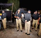 Karachi: Policemen stand guard at the blast site
