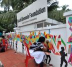 Kochi: Volunteers paint graffiti on the walls of Kochi Biennale Foundation office