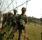 Lahore: Pakistani rangers patrol along the Pakistan-India border