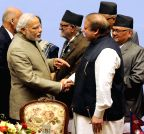 Nepal: PM Modi shakes hands with Nawaz Sharif at the 18th SAARC Summit