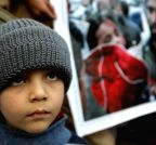 A Pakistani child attends a protest to condemn Tuesday's Taliban attack on the Army Public School