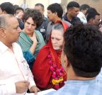 Raebareli: Sonia Gandhi and Priyanaka Gandhi Vadra with villagers