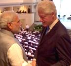 Singapore: Modi meetsBill Clinton