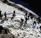 SDRF personnel remove snow from road in Kedarnath