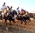 Tripoli (Libya): Libyan horse riders wearing desert costumes participate in an tradition show