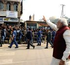 Varanasi: PM Modi greets people on the streets of Varanasi