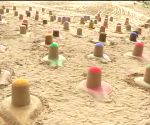 Sand artist creates 108 colourful Shiva lingams in Pushkar