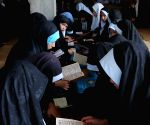 Afghan girls attend in class at a religious school in Ghazni province