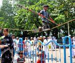 Boy performs balancing act