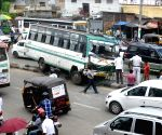 Bus rams into road divider