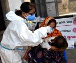 A health worker takes a nasal sample from a people for COVID-19 testing, in Patna