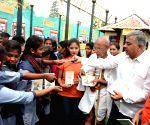 Lalbagh Republic Day Flower Show  - a man distributes Mahtma Gandhi's autobiography