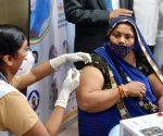A medic administers a COVID-19 vaccine to an elderly Woman Gulabo Devi during the second phase of the countrywide inoculation drive, at LNJP Hospital in New Delhi, Monday 01st March, 2021