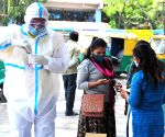 A medic collects swab samples for COVID-19 test, amid surge in corona virus cases across the country, in Bengaluru